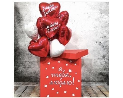 Коробка-сюрприз красного цвета с сердцами